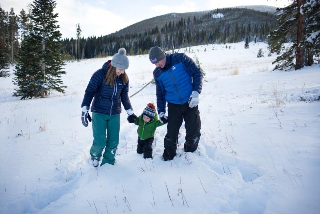 Chad, Diane, and Eli walking in the snow