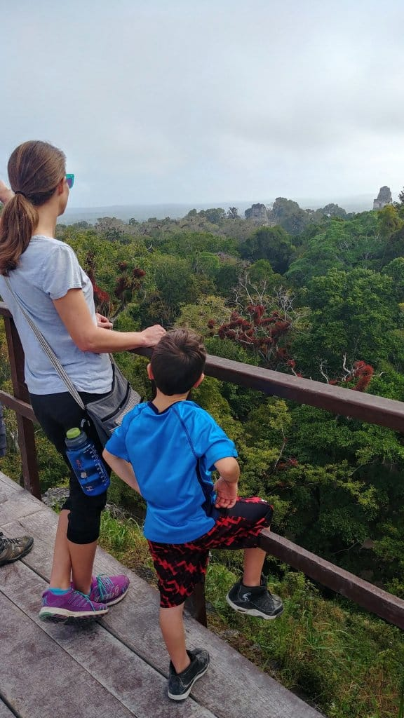 Diane and Eli looking at the View from the top of Temple III Tikal