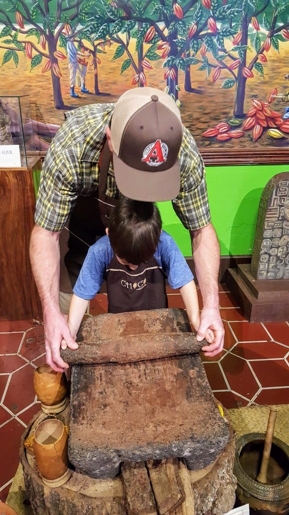 Chad and Eli grinding cocoa beans
