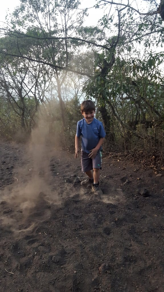 Eli playing in the dirt on the way down