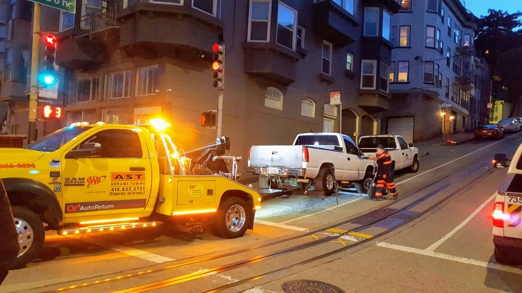 Tow Truck towing a truck that was blocking the cable car route