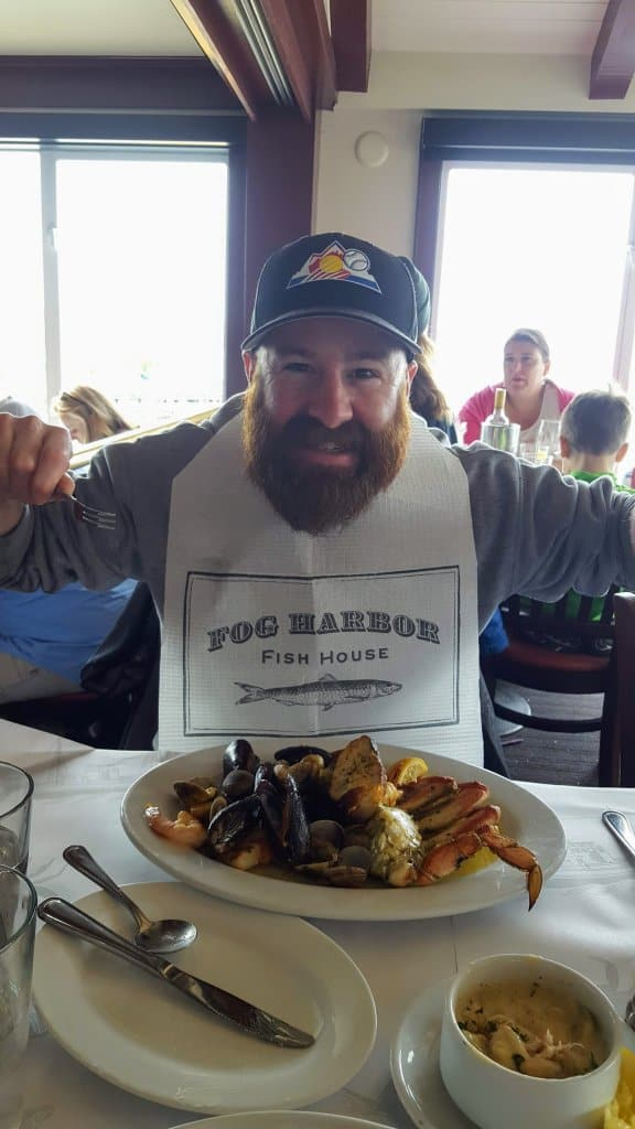 Chad digging in to a plate of shellfish at Fog Harbor Fish House in Fishermans Wharf