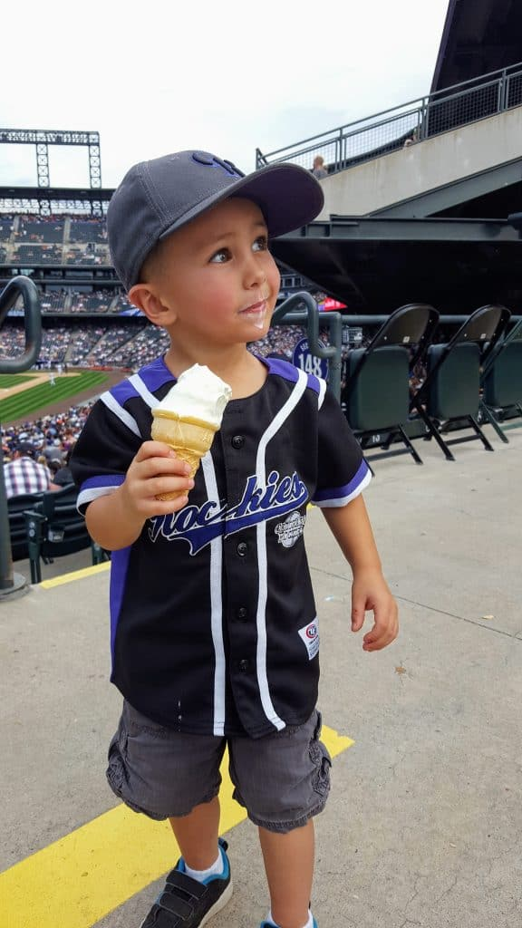 Eli eating a soft-serve ice cream cone at a rockies game
