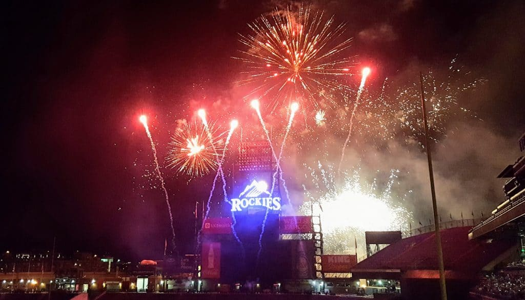 fireworks at coors field over the rockies sign