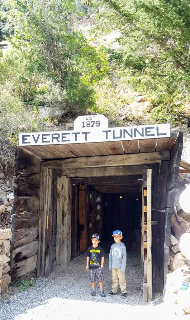Two boys in front of the entrance to the Everett Mine. One of the gold mine tours in Colorado