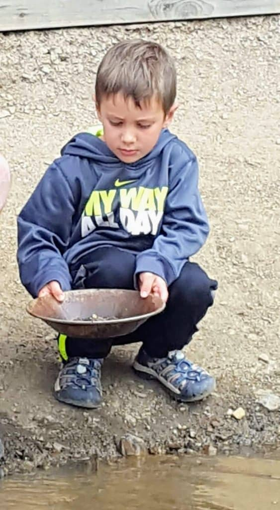 Eli panning for gold at Country Boy Mine in Breckenridge, Colorado