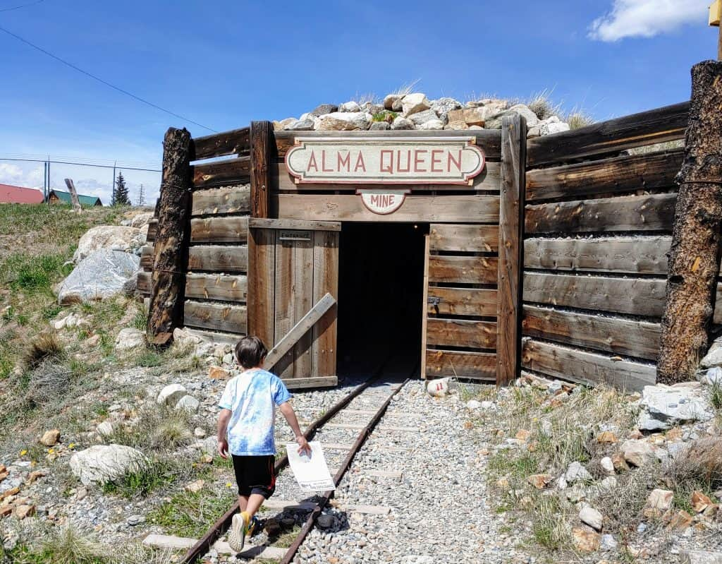 Eli walking into a mine in South Park City