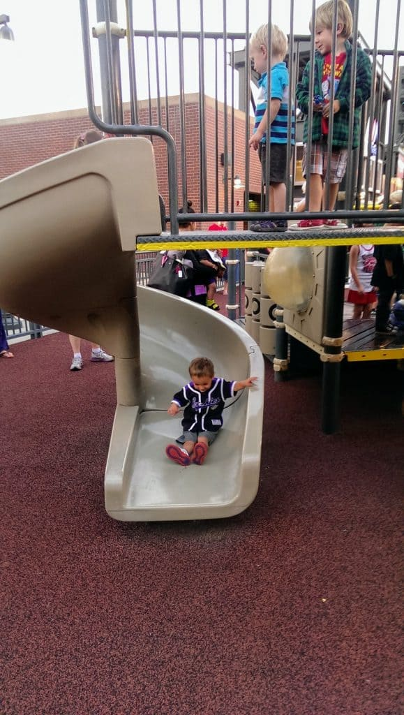Eli on a slide at Dinger's Playground at Coors Field