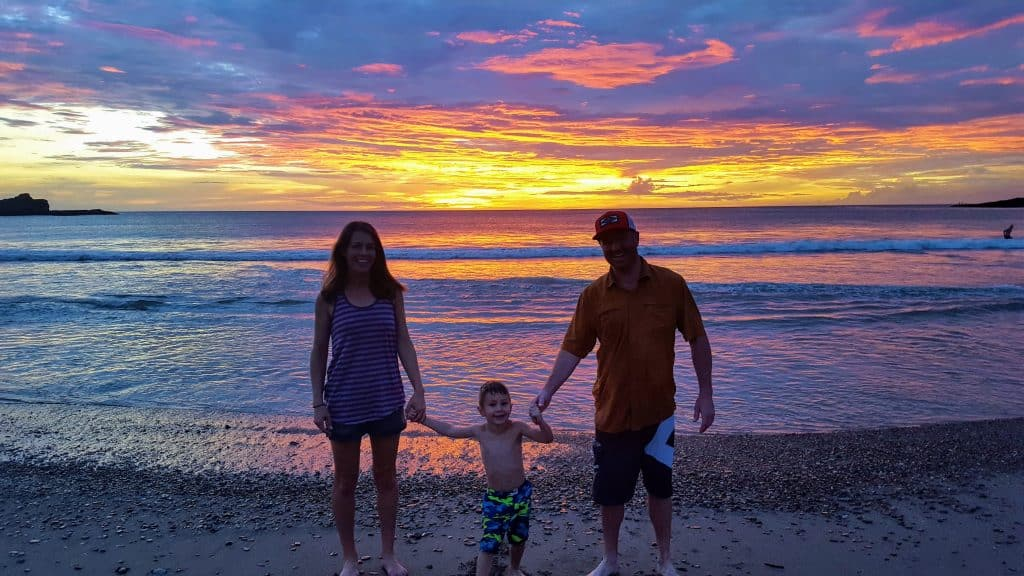 Family on Playa Marsella beach in front of a beautiful sunset
