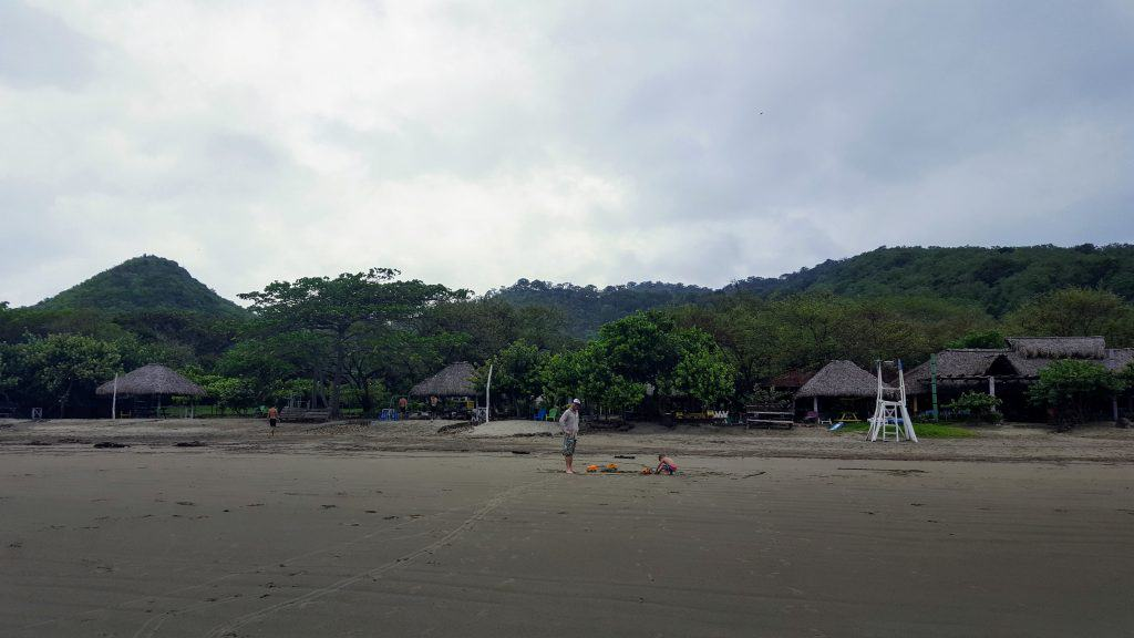 View of Playa Hermosa beach in Nicaragua from the ocean towards the resort