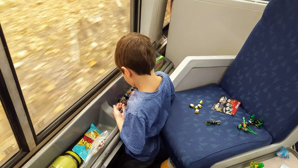 Eli playing with toys while riding the amtrak train