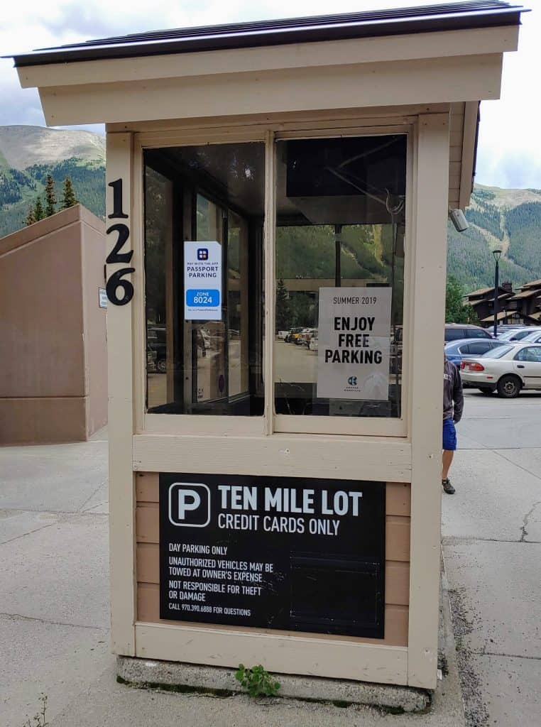 Ten Mile Lot at Copper Mountain with a sign about free parking in the summer