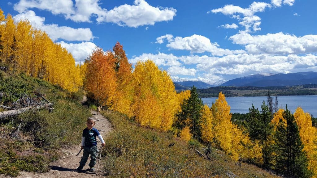 Boy hiking on the trail to Old Dillon Reservoir in Dillon, Colorado