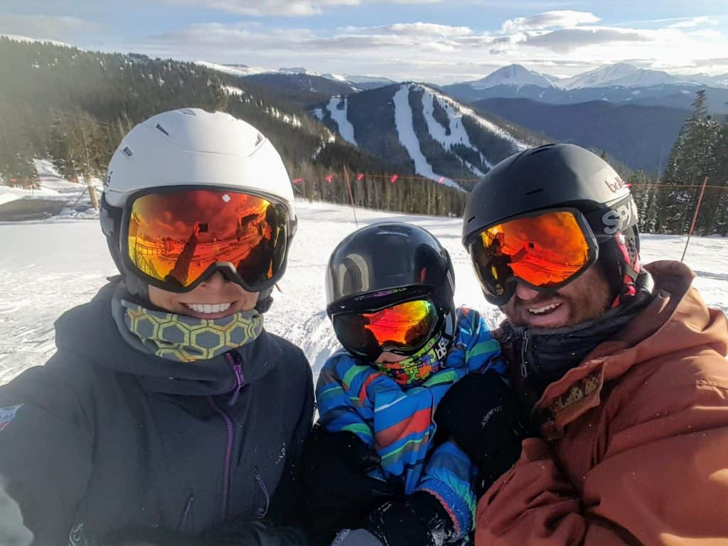 Chad, Diane, and Eli at the top of Keystone Mountain in the winter