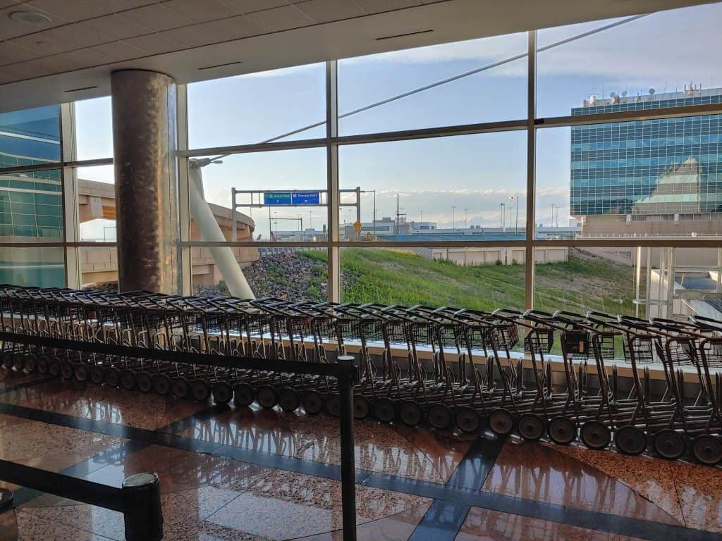 Denver International Airport  luggage carts with a window in the background