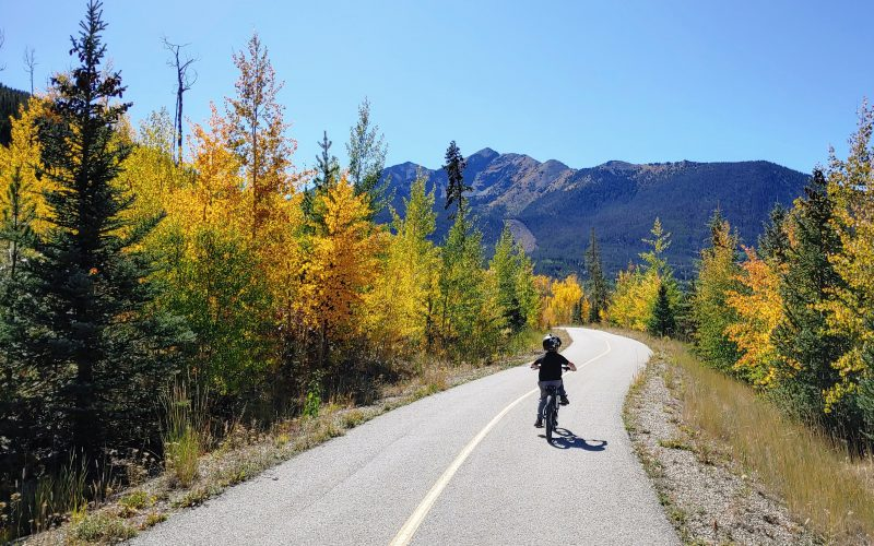 Boy on the bike path in Frisco, Colorado in the fall