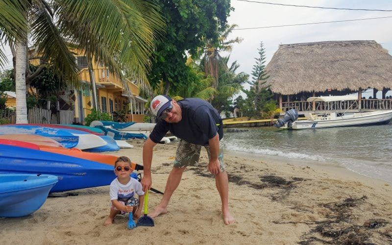 Father and son on the beach in Placencia, Belize