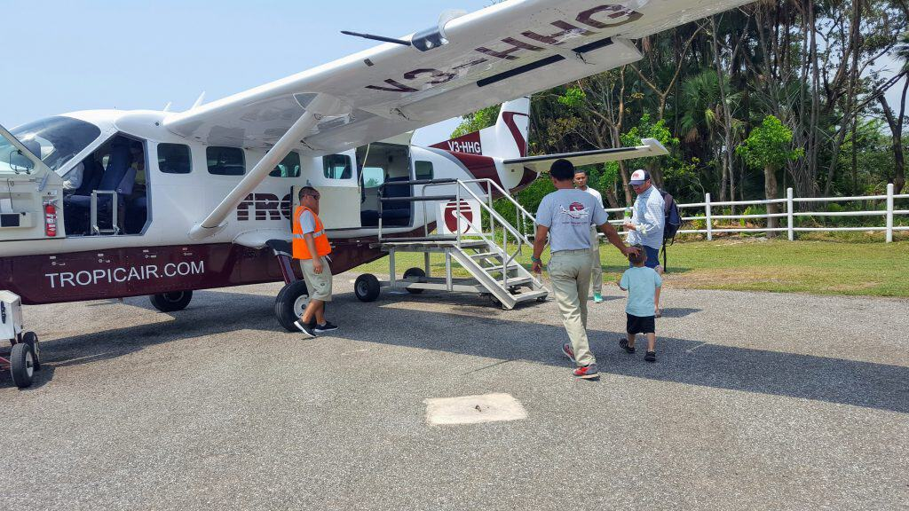 People getting on a small plane in Placencia Belize