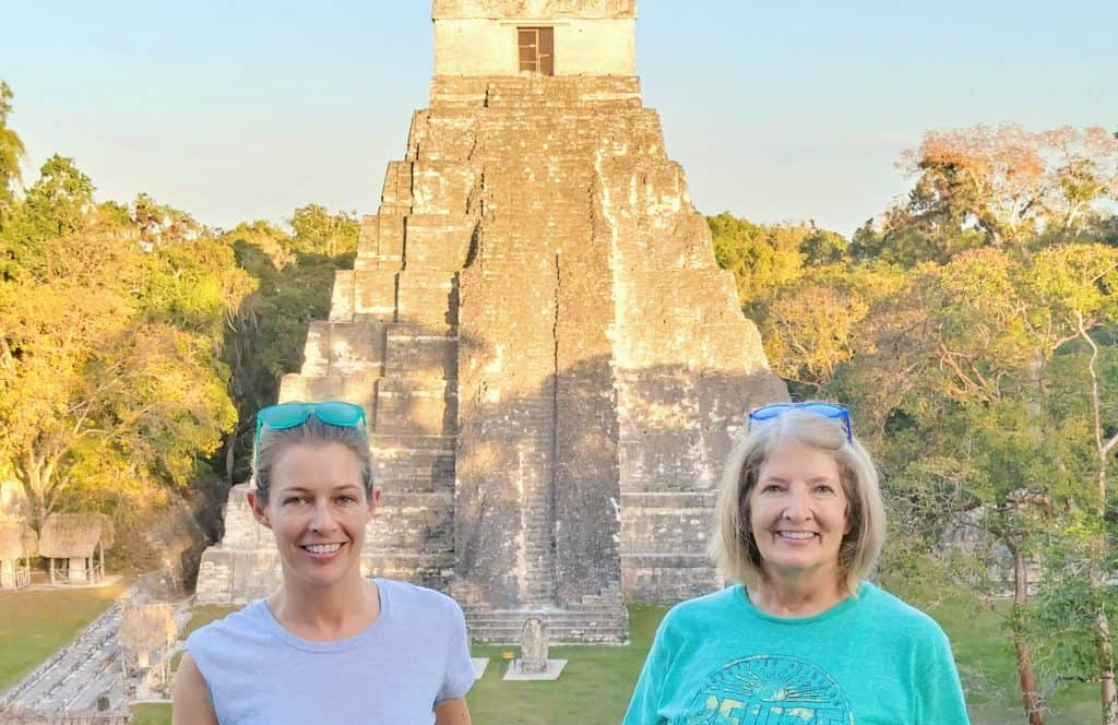 mom and daughter in front of a temple in tikal guatemala