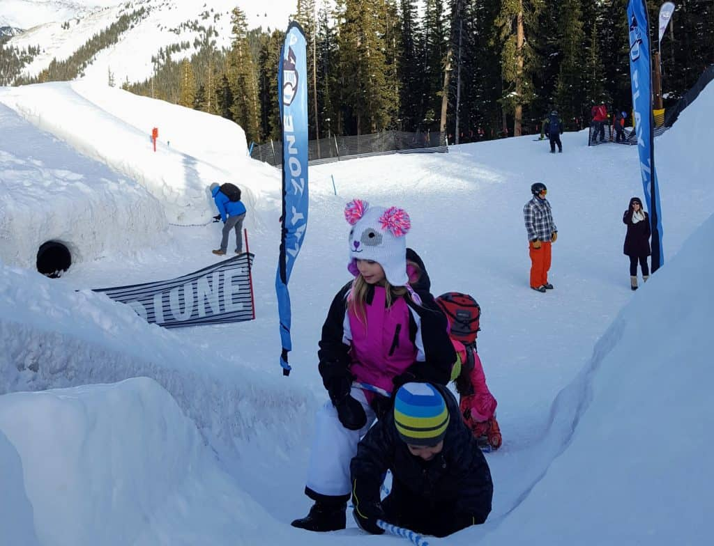kids playing on the gigantic snowfort at the top of Keystone Mountain in Colorado