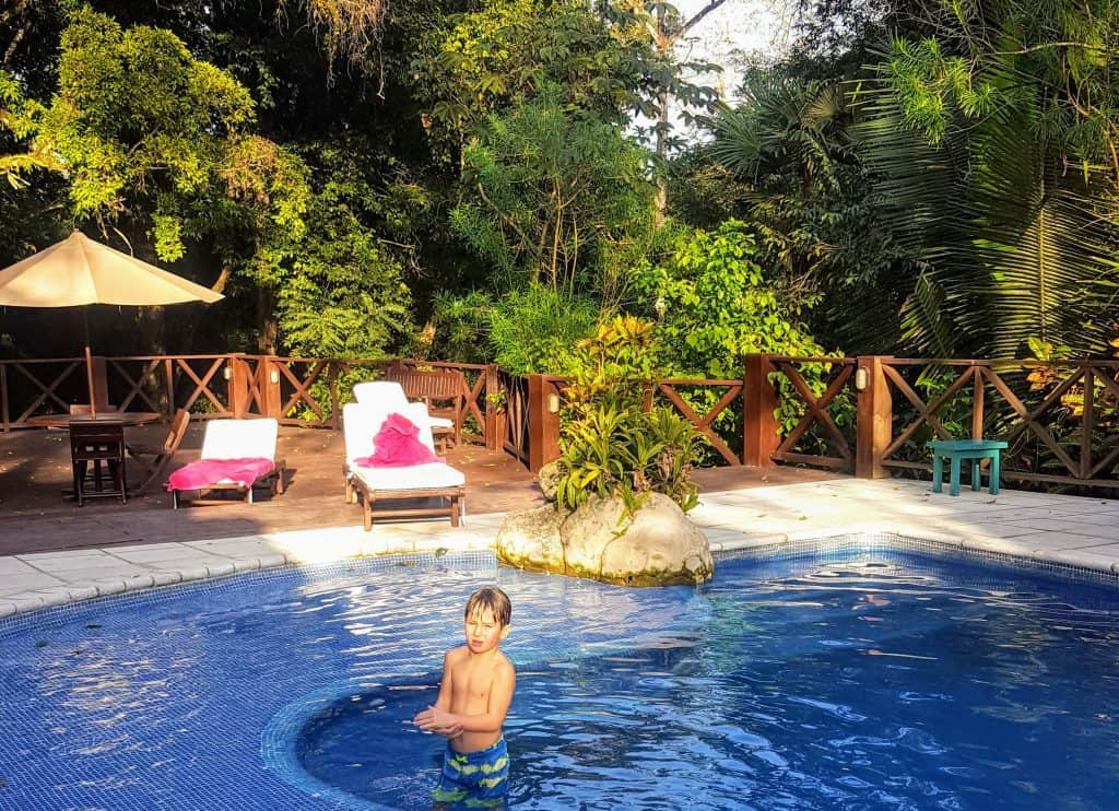 Boy in the pool at the Jungle Lodge in Tikal National Park Guatemala