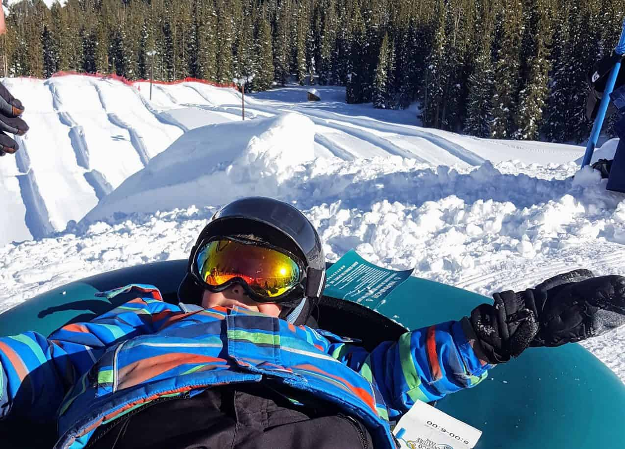 boy at the top of the tubing hill in keystone