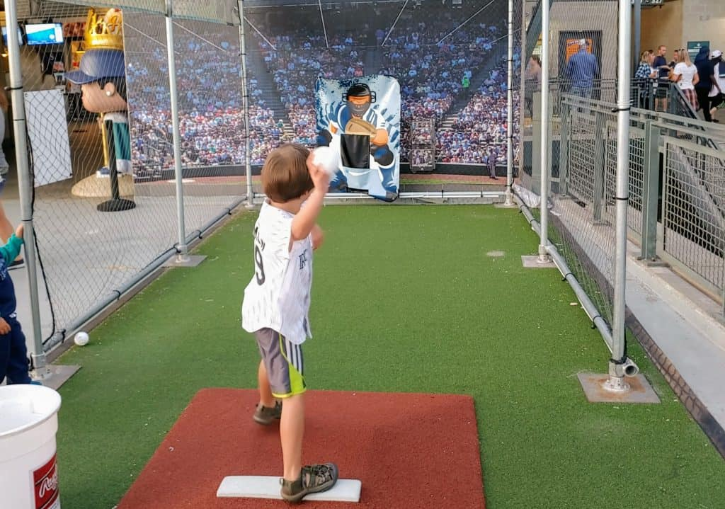 child using the free pitching practice set-up at the Mariners Stadium