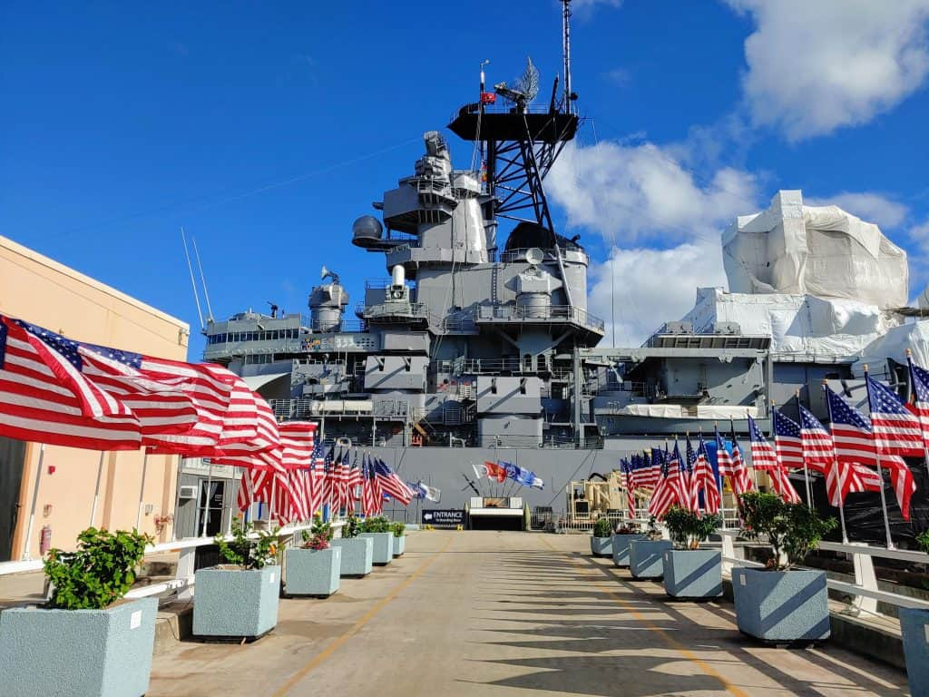 Battleship Missouri in the dock with American Flags