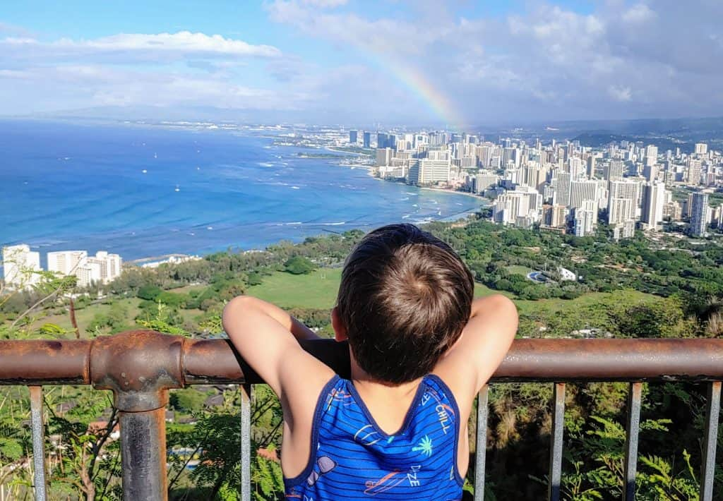 Boy looking out over Honolulu from Diamond Head
