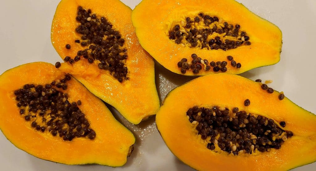 Papaya cut open with the seeds still in the middle - Fruit in Hawaii