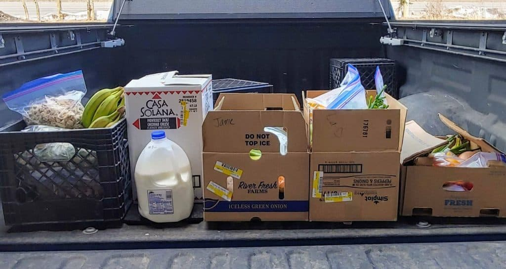 Food in boxes in the back of a truck