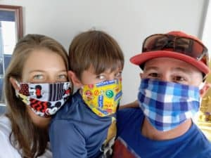 Family of 3 wearing face masks