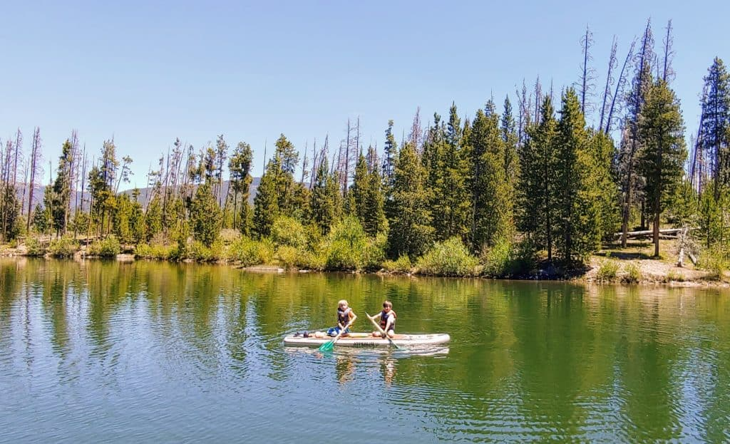 Two boys on a paddle board in Lake Dillon