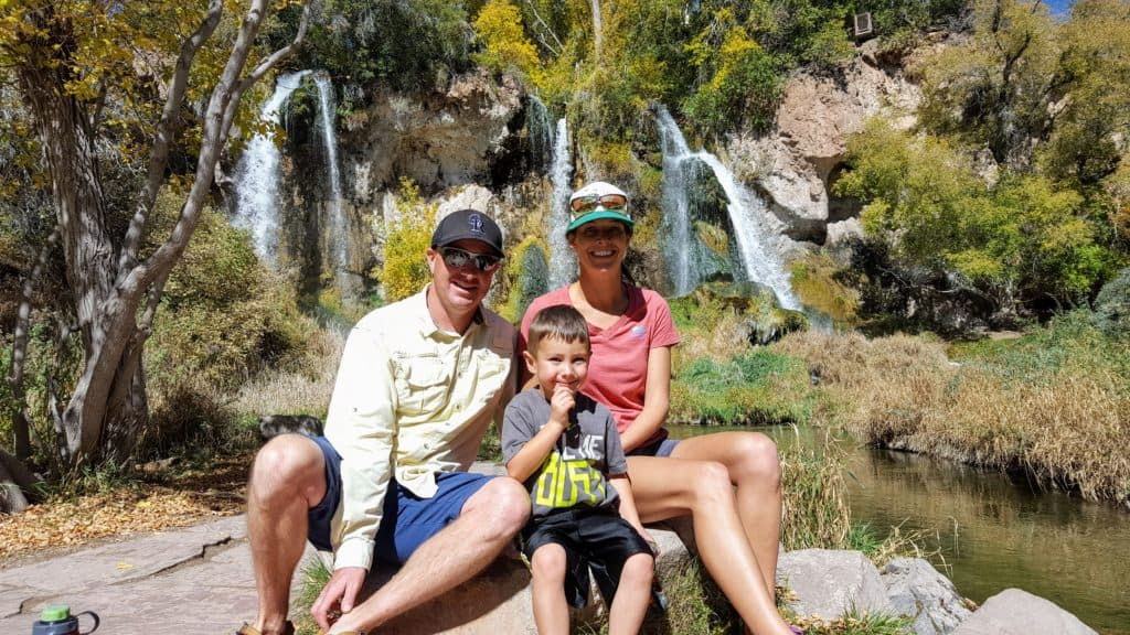 Family sitting in front of Rifle Falls
