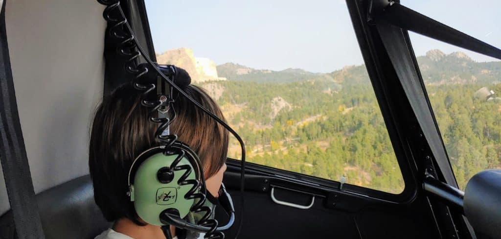 Child in a helicopter on a tour of the Black Hills of South Dakota