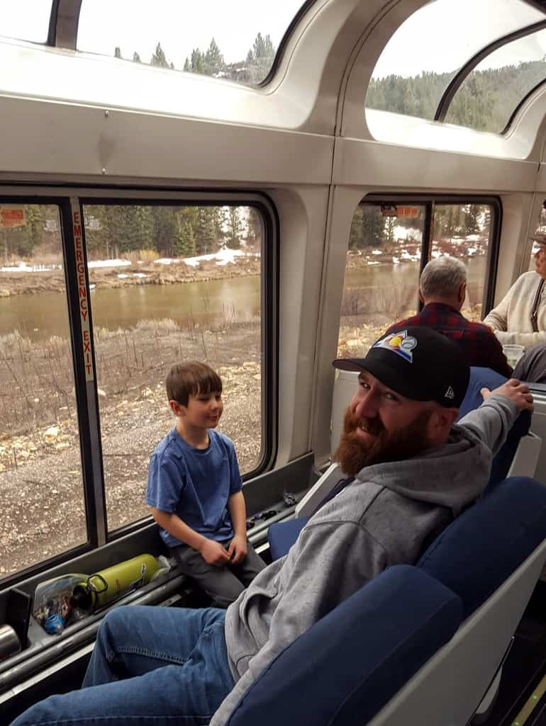 Father and son in the view car of the Amtrak California Zephyr through Colorado