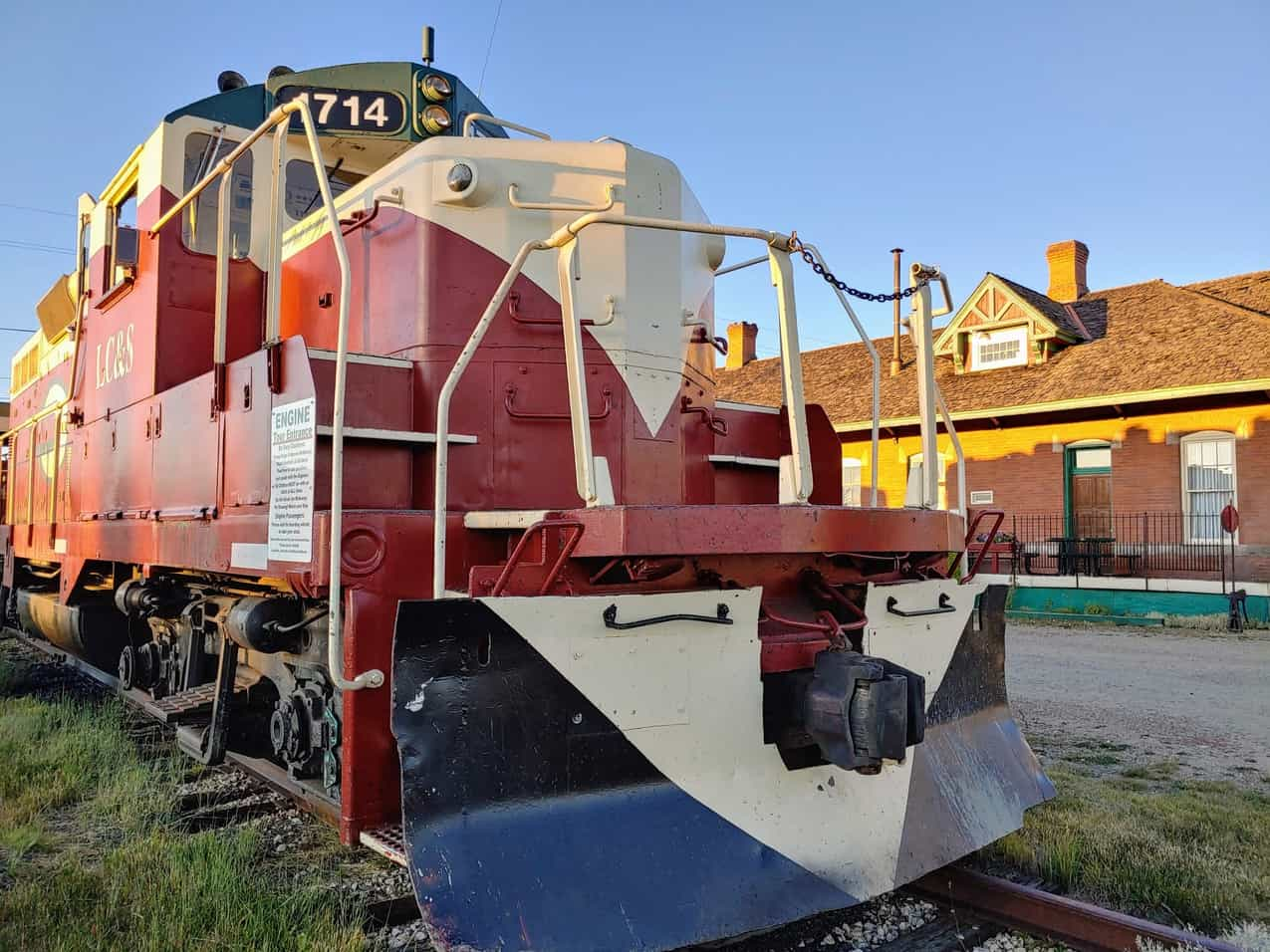 Front of a train engine on the tracks in front of the station in Leadville, Colorado