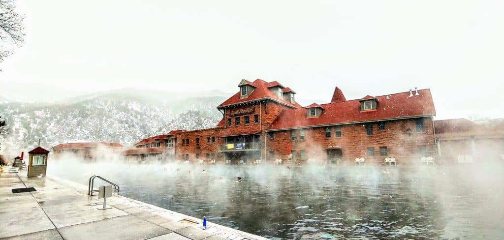steam rising from the natural hot springs pool in the winter time in glenwood springs colorado