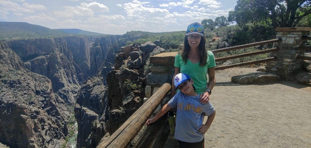 Mother and son standing at an overlook of Black Canyon of the Gunnison National Park