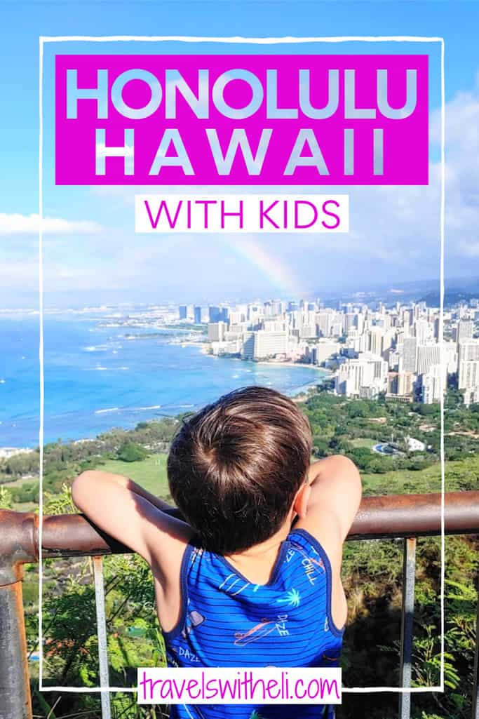 Boy looking at the city of Honolulu Hawaii from the top of Diamond Head